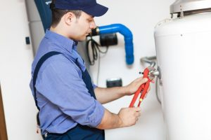technician repairing water heater in Mansfield