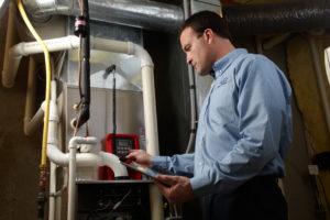 Technician working on HVAC unit